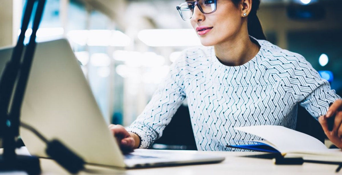 Woman studying master's in communication online