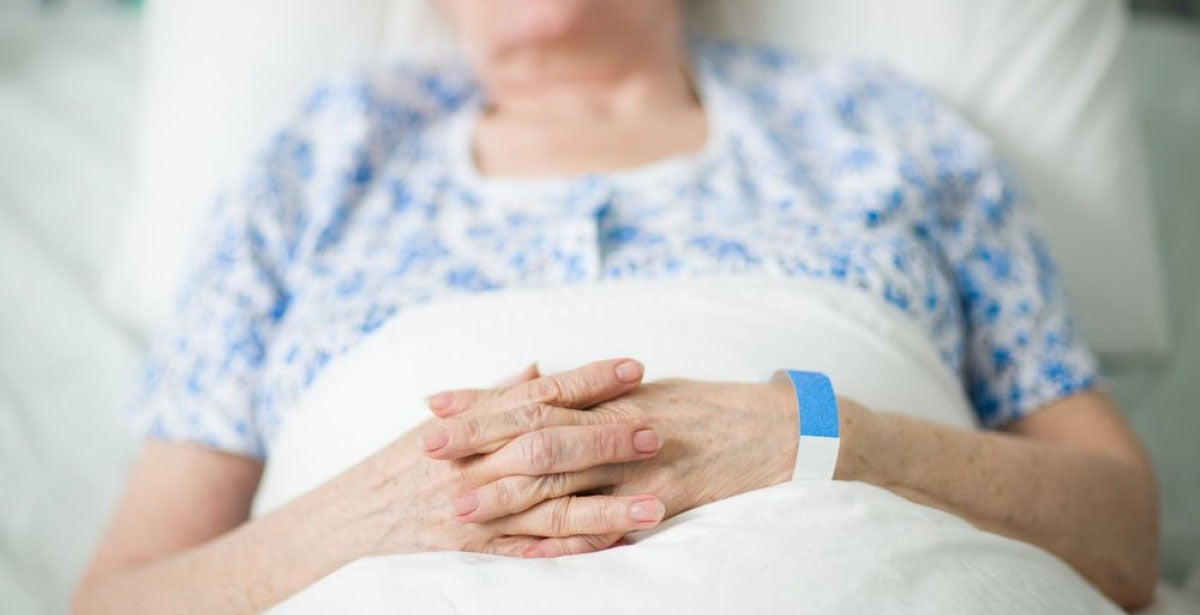 Geriatric nursing patient lying in bed