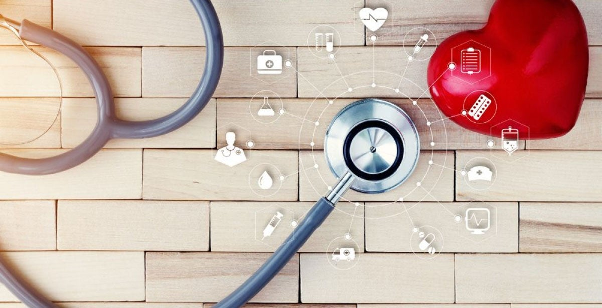 Stethoscope and heart against brick background