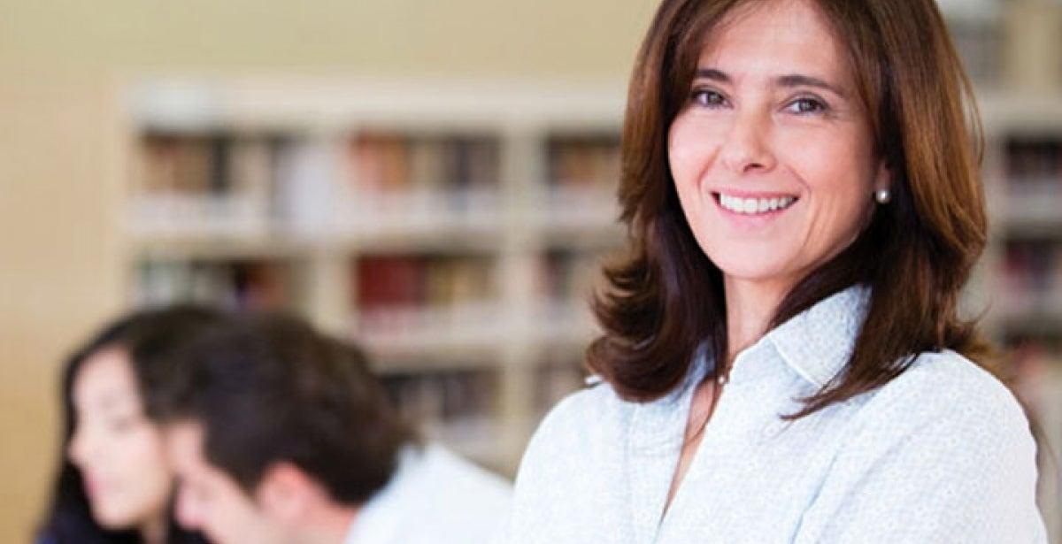 Smiling teacher in classroom