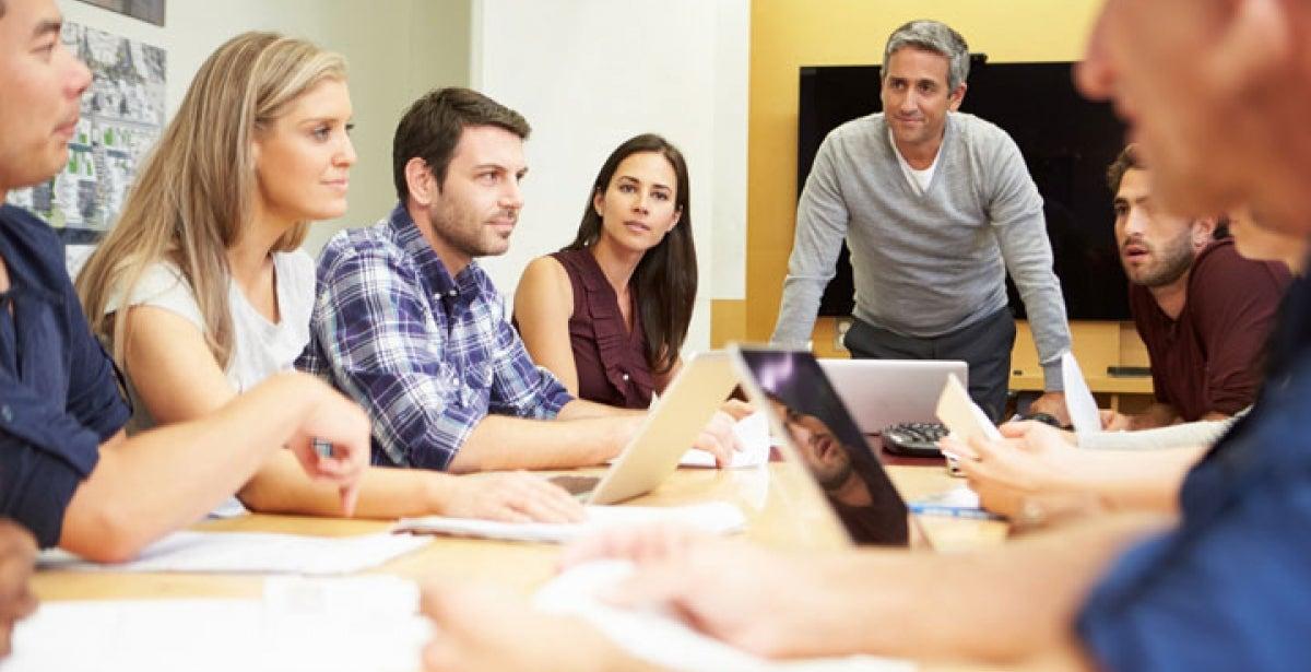 Digital content strategist leading team meeting