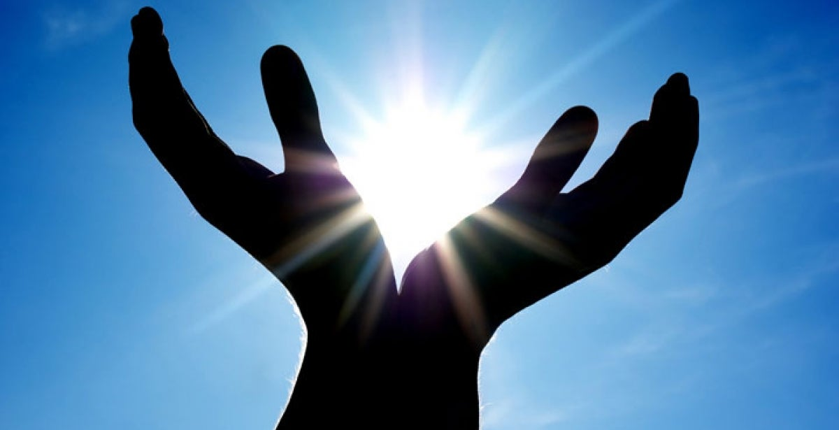 Hands positioned to look like they are holding the sun