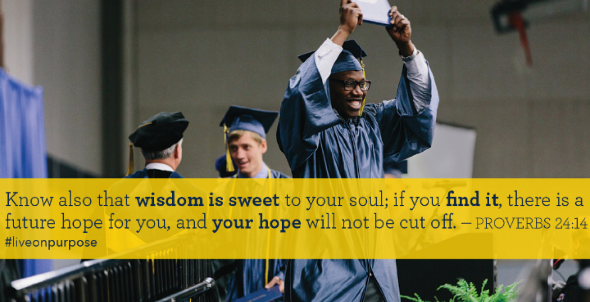 Man receiving college degree at graduation ceremony with inspirational quote