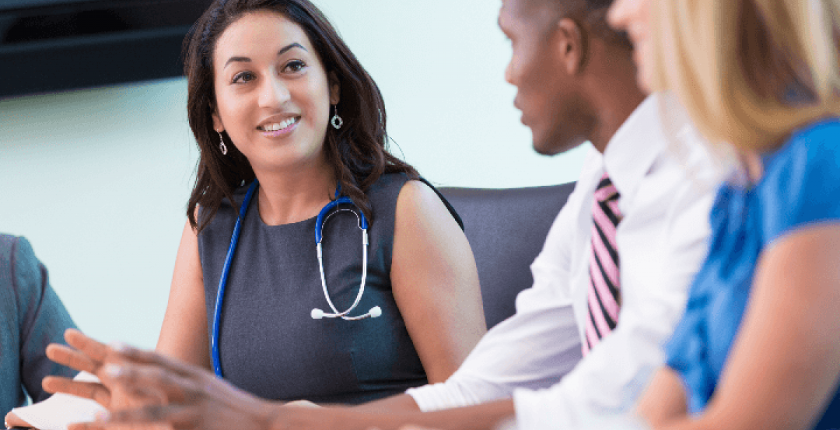 Nurse executive meeting with hospital staff