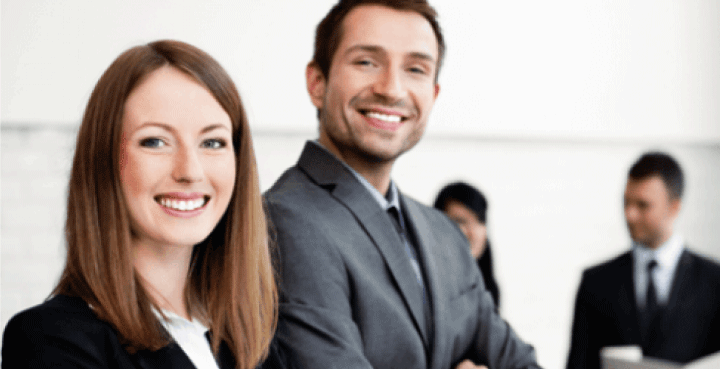 Smiling man and woman in business attire