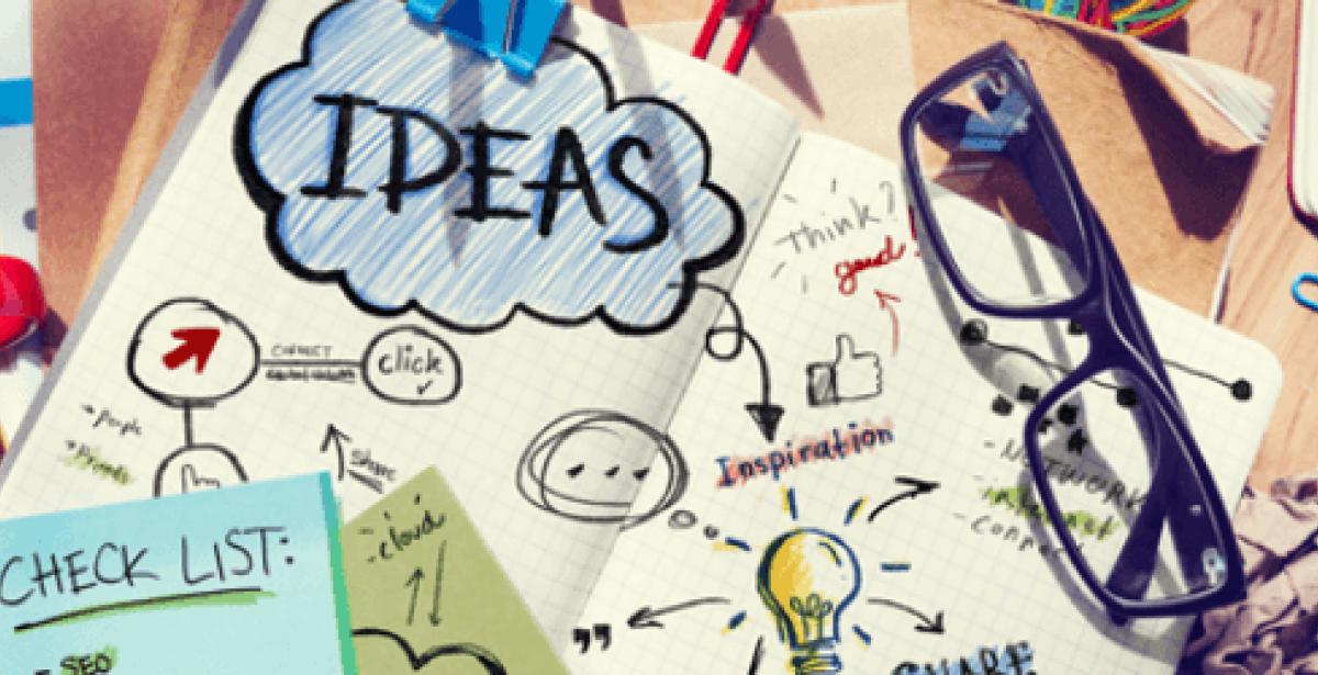 "Notebook on messy desk with ""Ideas"" written on it"
