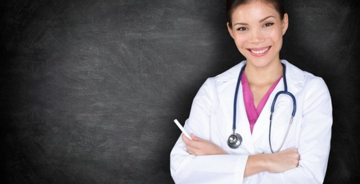 Nurse Educator smiling with crossed arms