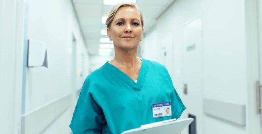 Nurse in hospital corridor