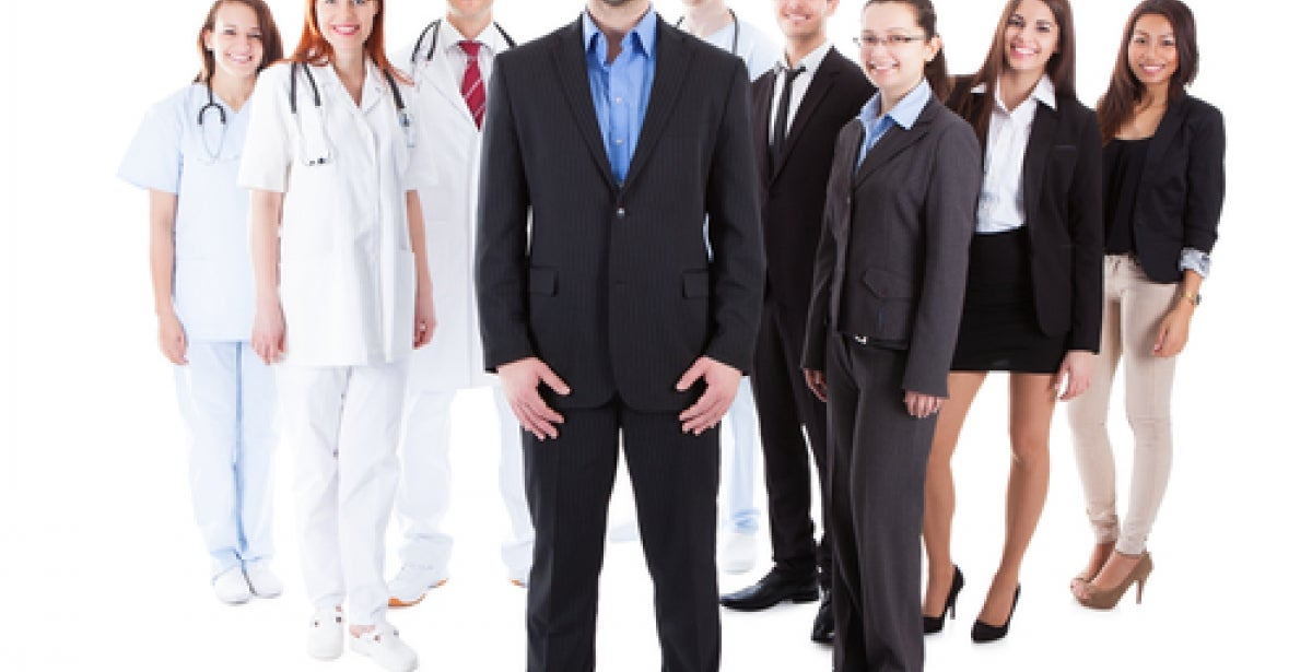 Group of people standing together in business attire and medical attire