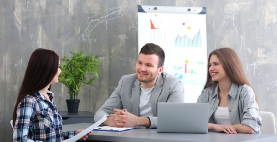 Human resources department meeting with employee in modern looking office