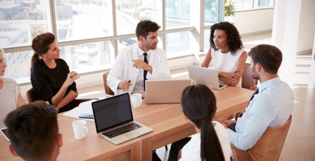 Healthcare professionals meeting in a boardroom